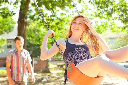 recreation - Young couple spend time on the swingset in park on a warm summer day in Portland, Oregon, USA Stock Photo - Premium Royalty-Free, Code: 600-06531465