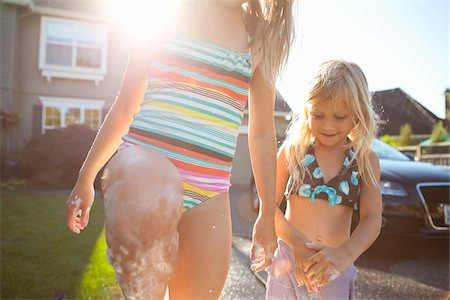 preteen bathing suit - Close-up of sisters washing car in driveway of their home on a sunny summer afternoon in Portland, Oregon, USA Stock Photo - Premium Royalty-Free, Code: 600-06531470