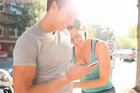 Couple Outdoors, Man using Cell Phone, Portland, Oregon, USA Stock Photo - Premium Royalty-Free, Code: 600-06531557