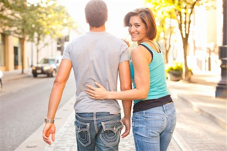 Couple Walking Outdoors, Woman Looking over Shoulder, Portland, Oregon, USA Stock Photo - Premium Royalty-Free, Code: 600-06531568
