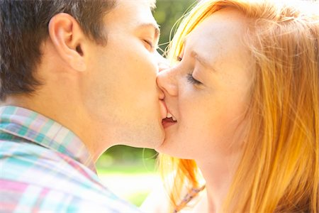 Young Couple Kissing in Park on a Summer Day, Portland, Oregon, USA Stock Photo - Premium Royalty-Free, Code: 600-06531636