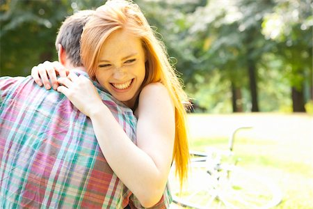 Young Couple Hugging in Park on a Summer Day, Portland, Oregon, USA Stock Photo - Premium Royalty-Free, Code: 600-06531630
