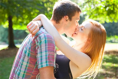 Young Couple Kissing in Park on a Summer Day, Portland, Oregon, USA Stock Photo - Premium Royalty-Free, Code: 600-06531633