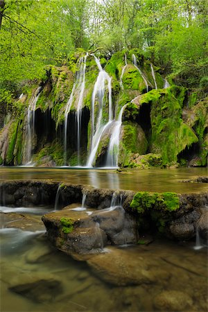 flowing - Waterfall cascading over green moss, Cascade des Tufs, Arbois, Jura, Jura Mountains, Franche-Comte, France Stock Photo - Premium Royalty-Free, Code: 600-06531785
