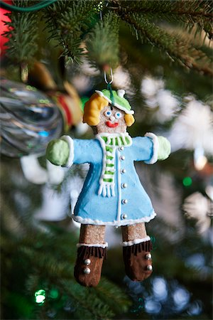 decorated gingerbread woman hanging as an ornament on a Christmas tree, Canada Stock Photo - Premium Royalty-Free, Code: 600-06532005