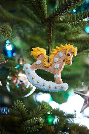 gingerbread rocking horse decorated with icing hanging on a pine tree as a Christmas ornament decoration, Canada Stock Photo - Premium Royalty-Free, Code: 600-06532003