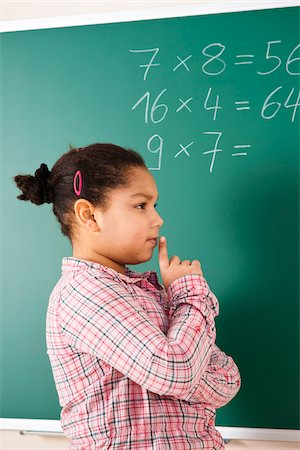 Girl Thinking in Classroom, Baden-Wurttemberg, Germany Stock Photo - Premium Royalty-Free, Code: 600-06548564