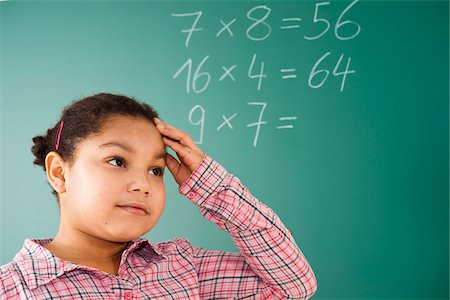 Girl Thinking in Classroom, Baden-Wurttemberg, Germany Stock Photo - Premium Royalty-Free, Code: 600-06548565