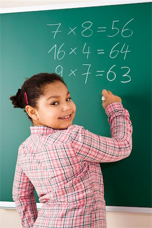 Girl Answering Question at Blackboard in Classroom, Baden-Wurttemberg, Germany Stock Photo - Premium Royalty-Free, Code: 600-06548567