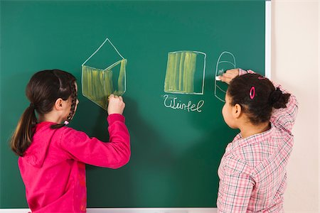 Girls Drawing on Blackboard in Classroom, Baden-Wurttemberg, Germany Stock Photo - Premium Royalty-Free, Code: 600-06548571