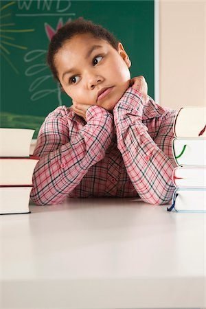 Girl and Textbooks in Classroom, Baden-Wurttemberg, Germany Stock Photo - Premium Royalty-Free, Code: 600-06548587