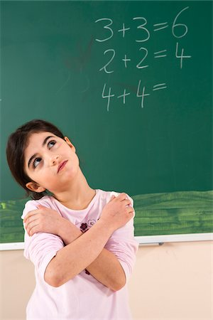 Girl Answering Question at Blackboard in Classroom, Baden-Wurttemberg, Germany Stock Photo - Premium Royalty-Free, Code: 600-06548614