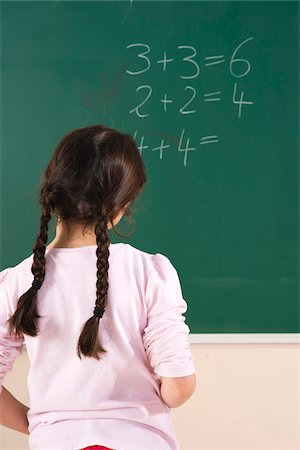 Girl Answering Question at Blackboard in Classroom, Baden-Wurttemberg, Germany Stock Photo - Premium Royalty-Free, Code: 600-06548615