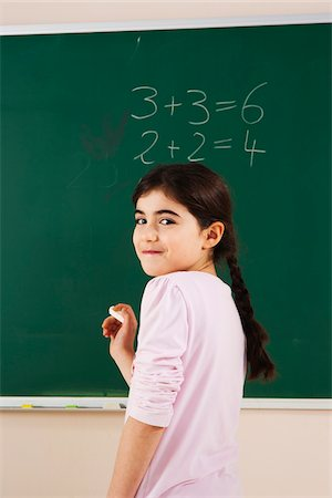 Girl Answering Question at Blackboard in Classroom, Baden-Wurttemberg, Germany Stock Photo - Premium Royalty-Free, Code: 600-06548616