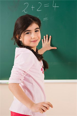 Girl Answering Question at Blackboard in Classroom, Baden-Wurttemberg, Germany Stock Photo - Premium Royalty-Free, Code: 600-06548618