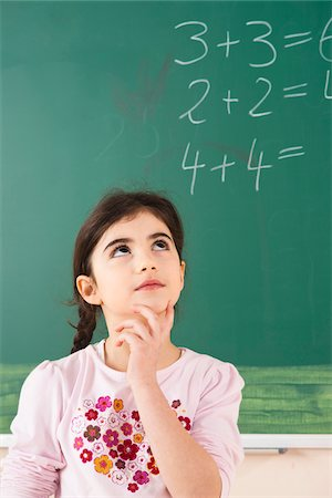 Girl Answering Question at Blackboard in Classroom, Baden-Wurttemberg, Germany Stock Photo - Premium Royalty-Free, Code: 600-06548613