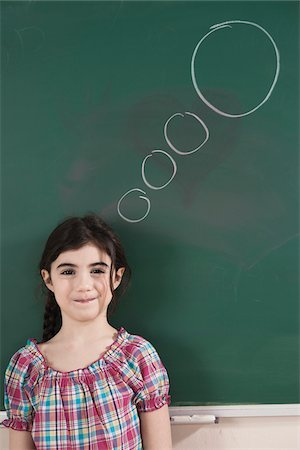 drawing (artwork) - Girl in Front of Chalkboard with Thought Bubble in Classroom Stock Photo - Premium Royalty-Free, Code: 600-06543534