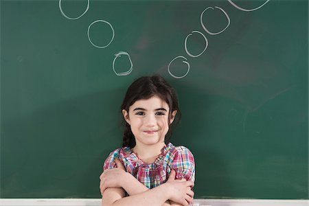 drawing - Girl in front of Chalkboard with Thought Bubbles in Classroom Stock Photo - Premium Royalty-Free, Code: 600-06543535
