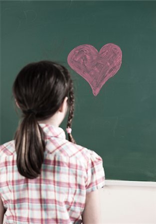 focus on background - Back of Girl Looking at Heart drawn in Chalk on Chalkboard in Classroom Stock Photo - Premium Royalty-Free, Code: 600-06543531