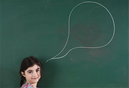 drawing - Girl in front of Chalkboard with Speech Bubble in Classroom Stock Photo - Premium Royalty-Free, Code: 600-06543544