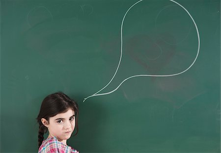 drawing (artwork) - Girl in front of Chalkboard with Speech Bubble in Classroom Stock Photo - Premium Royalty-Free, Code: 600-06543543