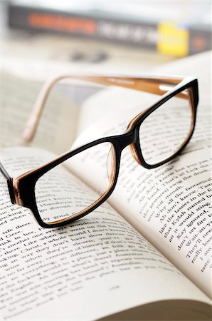 page - Close-up of Eyeglasses on Open Book Stock Photo - Premium Royalty-Free, Code: 600-06553462