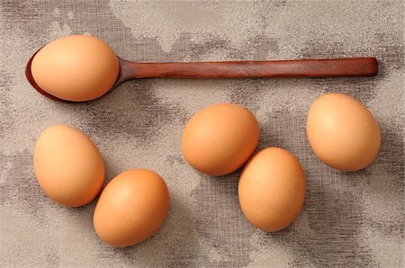 Overhead View of Eggs and Wooden Spoon Stock Photo - Premium Royalty-Free, Code: 600-06553493