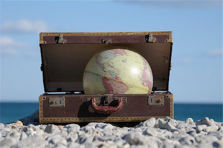 Globe in Suitcase on Rocky Beach, Frontignan, Herault, France Stock Photo - Premium Royalty-Free, Code: 600-06553503