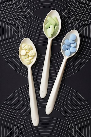 Overhead View of Pills on Spoons Stock Photo - Premium Royalty-Free, Code: 600-06553515
