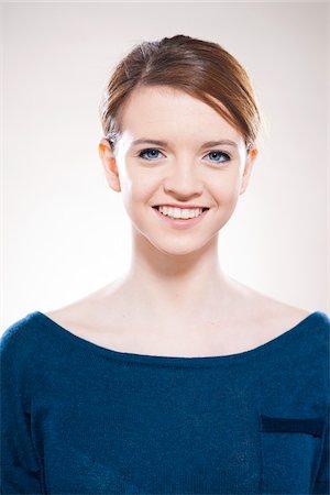 Head and Shoulders Portrait of Teenage Girl in Studio Stock Photo - Premium Royalty-Free, Code: 600-06570911