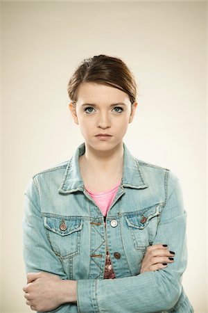 Portrait of Teenage Girl, in Studio Stock Photo - Premium Royalty-Free, Code: 600-06570937