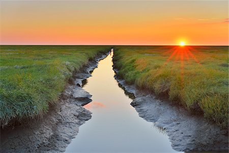 sun - Tide Way, Westerheversand at Sunset in the Summer, Westerhever, Tating, Schleswig-Holstein, Germany Stock Photo - Premium Royalty-Free, Code: 600-06571075