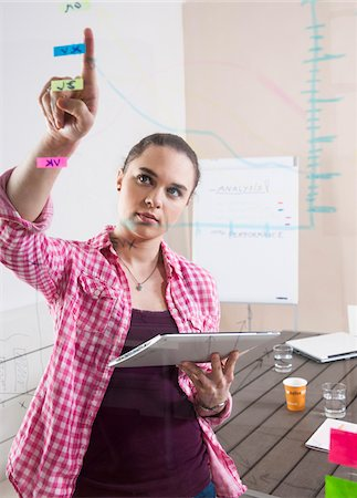 drawing computer - Young Woman Working in an Office, Looking Through Glass Board, Germany Stock Photo - Premium Royalty-Free, Code: 600-06620940