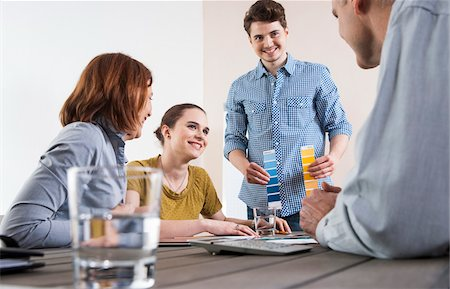 Business People Working and Meeting in Office, Looking at Color Swatches Stock Photo - Premium Royalty-Free, Code: 600-06620996