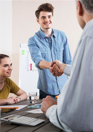 Young Businessman in Business Meeting, Shaking Hands with Business Associate Stock Photo - Premium Royalty-Free, Code: 600-06620999