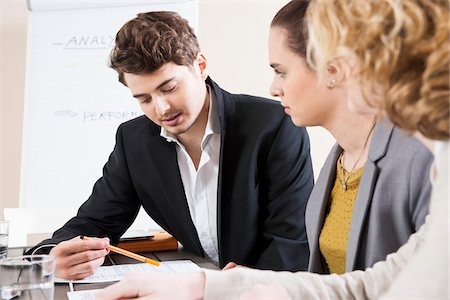 Young Business People at Meeting in Boardroom Stock Photo - Premium Royalty-Free, Code: 600-06621016