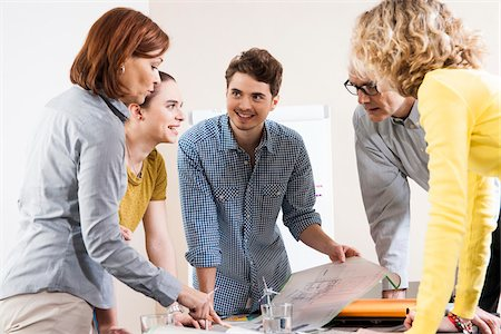 Business People in Meeting Looking at Plans and Model of Windmill Stock Photo - Premium Royalty-Free, Code: 600-06621013