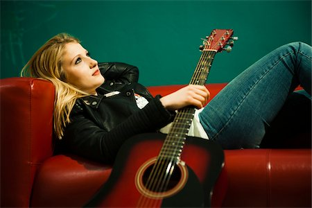 female only - Woman Lying on Sofa and Holding Acoustic Guitar Stock Photo - Premium Royalty-Free, Code: 600-06675137