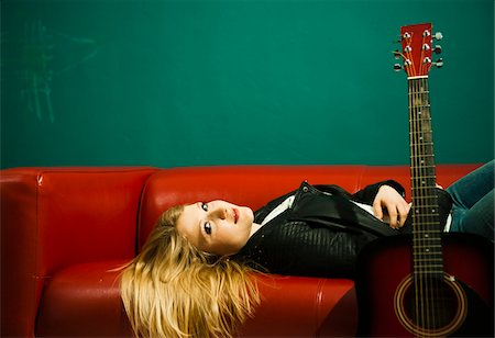 Woman Lying on Sofa with Acoustic Guitar Stock Photo - Premium Royalty-Free, Code: 600-06675139