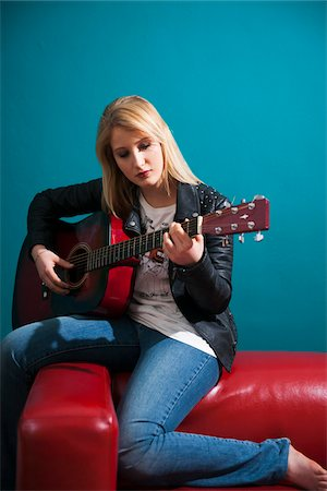 Woman Playing Acoustic Guitar Stock Photo - Premium Royalty-Free, Code: 600-06675151