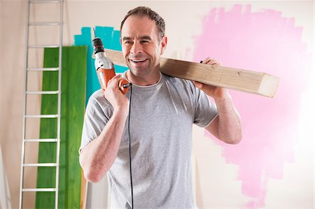 paint - Mature Man Renovating his Home Stock Photo - Premium Royalty-Free, Code: 600-06679376