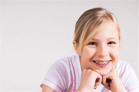 preteen  smile  one  alone - Portrait of Girl with Braces in Studio Stock Photo - Premium Royalty-Free, Code: 600-06685163