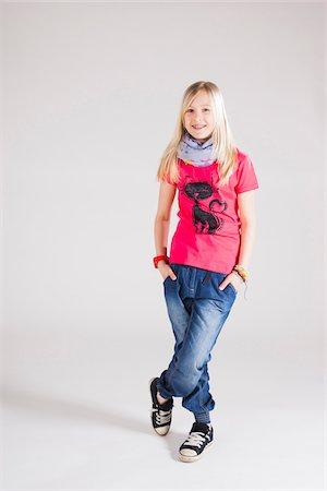 Full Length Portrait of Girl in Studio Stock Photo - Premium Royalty-Free, Code: 600-06685180