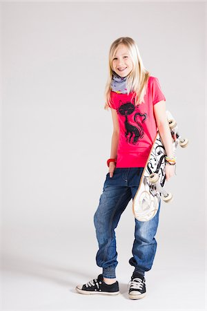 Full Length Portrait of Girl with Skateboard in Studio Stock Photo - Premium Royalty-Free, Code: 600-06685182