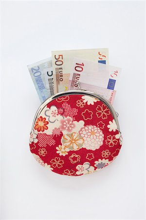 Close-up of Floral Patterned Change Purse with Euro Notes Sticking Out, Studio Shot on White Background Stock Photo - Premium Royalty-Free, Code: 600-06701754