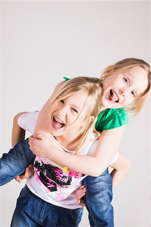 Portrait of Girls Having Fun in Studio Stock Photo - Premium Royalty-Free, Code: 600-06701800