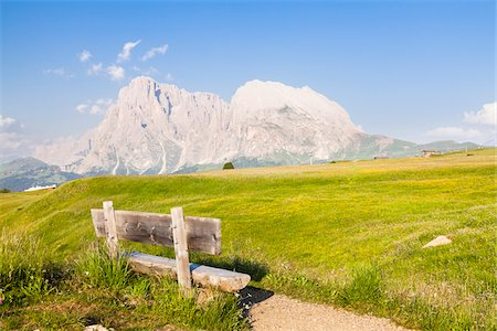 Bench by Alpine Meadow, Seiser Alm, Sassolungo and Plattkofel Mountain, Dolomites, South Tyrol, Italy Stock Photo - Premium Royalty-Free, Code: 600-06701860