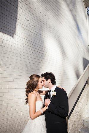 Portrait of Bride and Groom Kissing, Toronto, Ontario, Canada Stock Photo - Premium Royalty-Free, Code: 600-06701870