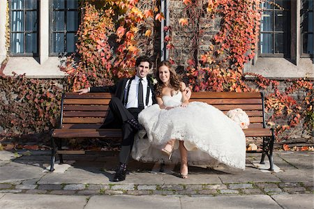 people sitting on bench - Portrait of Bride and Groom Sitting on Bench in Autumn, Toronto, Ontario, Canada Stock Photo - Premium Royalty-Free, Code: 600-06701871