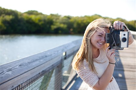 Young Woman on walkway with Camera, Palm Beach Gardens, Palm Beach County, Florida, USA Stock Photo - Premium Royalty-Free, Code: 600-06701896